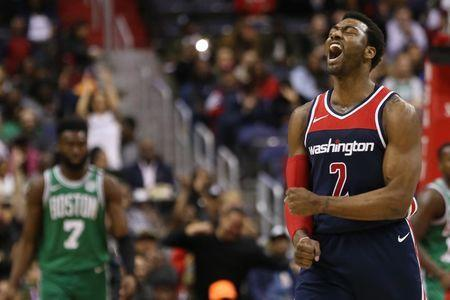 FILE PHOTO - Apr 10, 2018; Washington, DC, USA; Washington Wizards guard John Wall (2) reacts after a three point field goal by Wizards forward Kelly Oubre Jr. (not pictured) against the Boston Celtics in the fourth quarter at Capital One Arena. Mandatory Credit: Geoff Burke-USA TODAY Sports