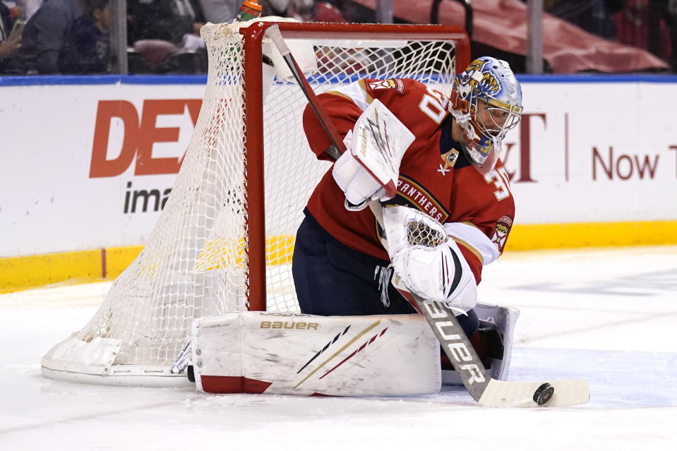 Florida Panthers goaltender Spencer Knight (30) stops a shot on the goal during the first period in Game 5 of an NHL hockey Stanley Cup first-round playoff series against the Tampa Bay Lightning, Monday, May 24, 2021, in Sunrise, Fla. (AP Photo/Lynne Sladky)
