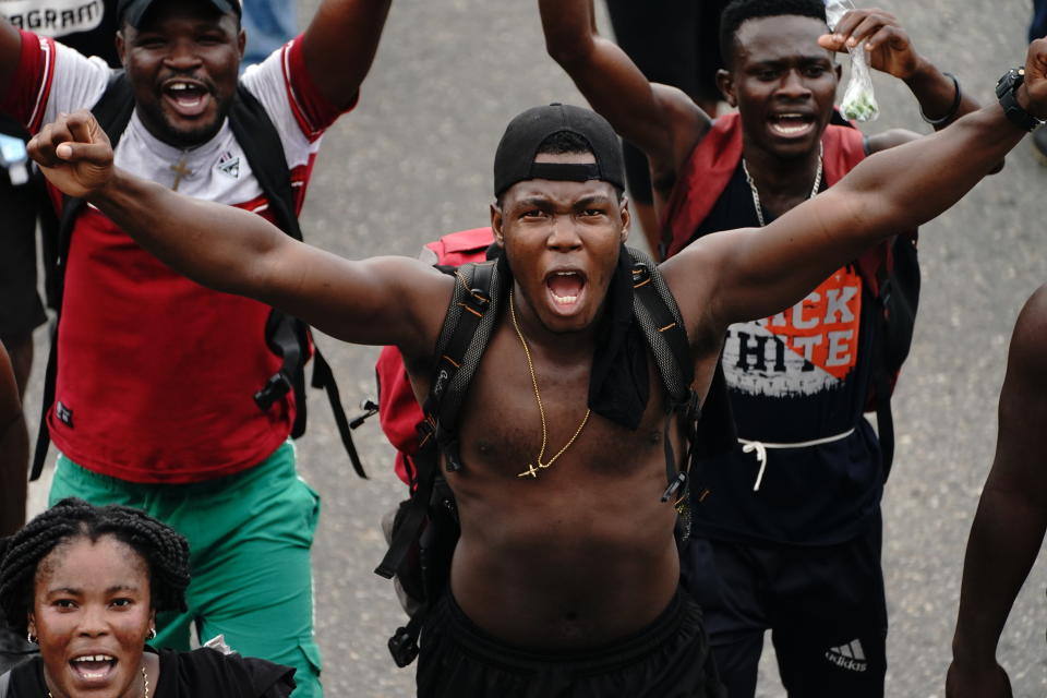 Migrants who are part of a caravan heading north, cheer after passing a checkpoint along the Huehuetan highway, Chiapas state, Mexico, Saturday, Sept. 4, 2021. (AP Photo/Marco Ugarte)