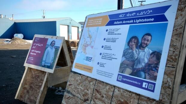 Campaign posters are already up at the major intersections in Iqaluit, with only one month to go before the Oct. 25 Nunavut election. (Matisse Harvey/Radio-Canada - image credit)