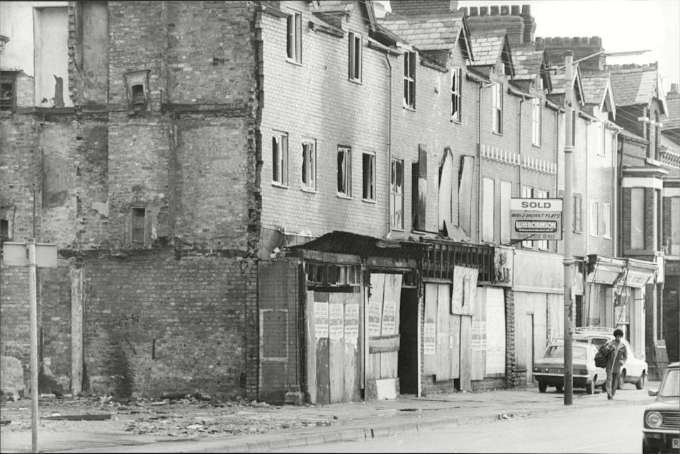 Shuttered shops after the Moss Side riots, 1981.