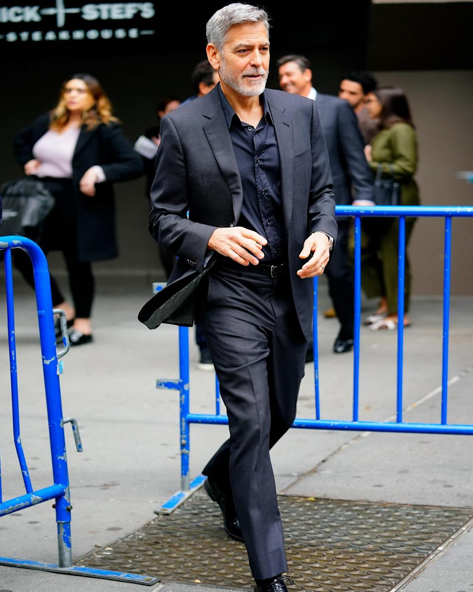 """<h1 class=""""title"""">May 1: George Clooney</h1> <div class=""""caption""""> Me when I see George Clooney wearing a big fit. </div> <cite class=""""credit"""">Jackson Lee</cite>"""