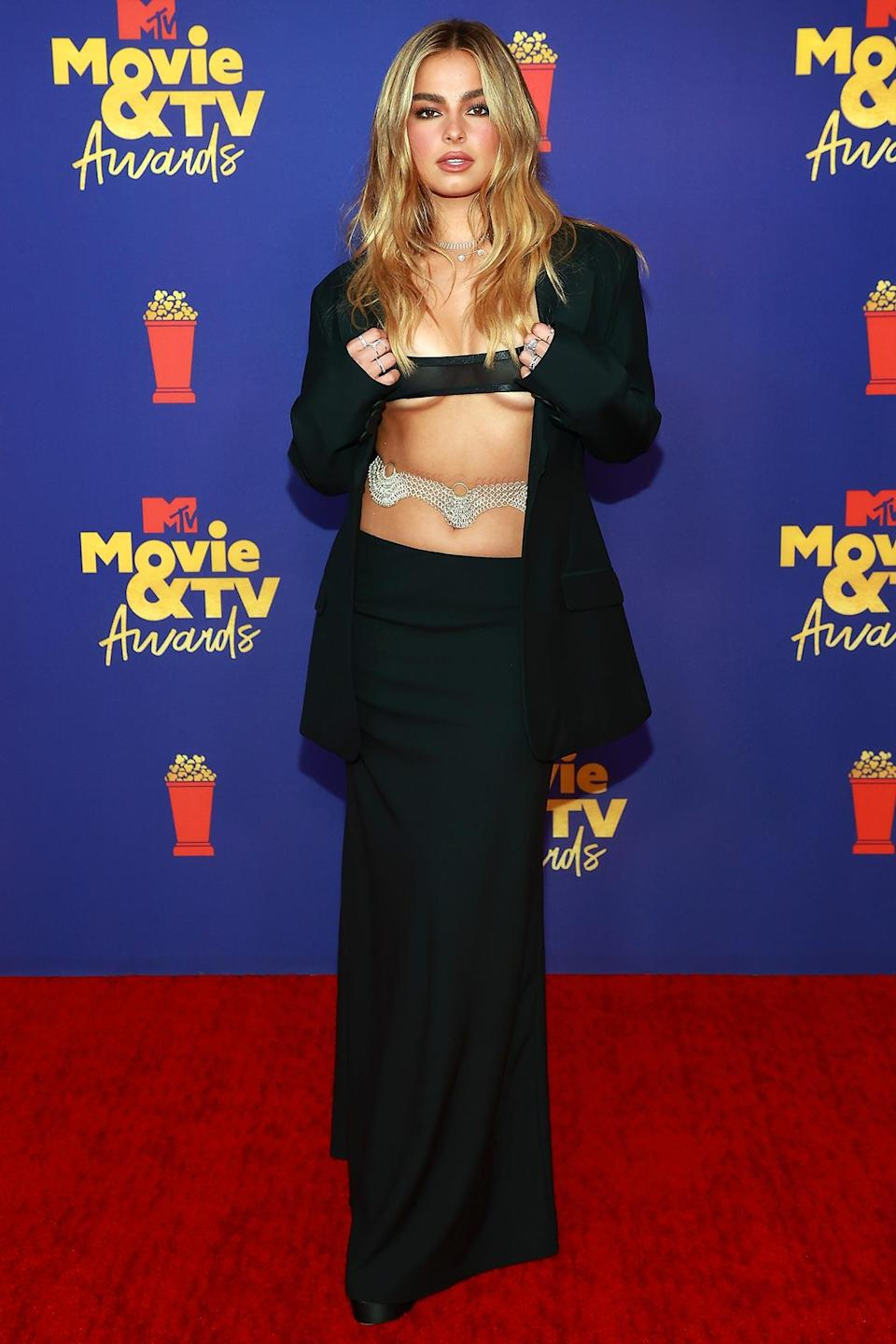 <p>in a barely-there top and body chain at the 2021 Movie & TV Awards.</p>