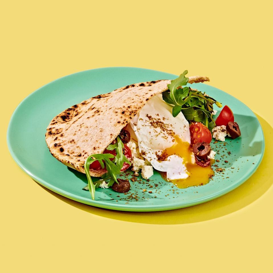 """<p>This flavorful sandwich comes together in a whole-grain pita to give you a quick protein- and fiber-packed breakfast that's easy to take on the go. <a href=""""https://www.eatingwell.com/recipe/7897310/feta-egg-olive-pita/"""" rel=""""nofollow noopener"""" target=""""_blank"""" data-ylk=""""slk:View recipe"""" class=""""link rapid-noclick-resp""""> View recipe </a></p>"""