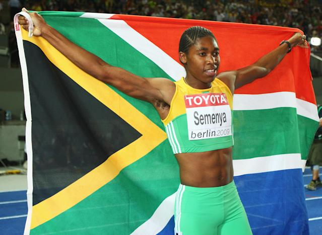 BERLIN - AUGUST 19: Caster Semenya of South Africa celebrates winning the gold medal in the women's 800 Metres Final during day five of the 12th IAAF World Athletics Championships at the Olympic Stadium on August 19, 2009 in Berlin, Germany. (Photo by Michael Steele/Getty Images)