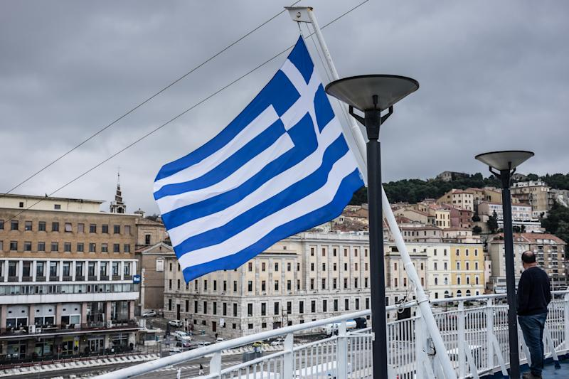 A man standing at a Greek Flag on a ship in the harbor of Ancona on November 20, 2019(Photo by Wassilios Aswestopoulos/NurPhoto via Getty Images)