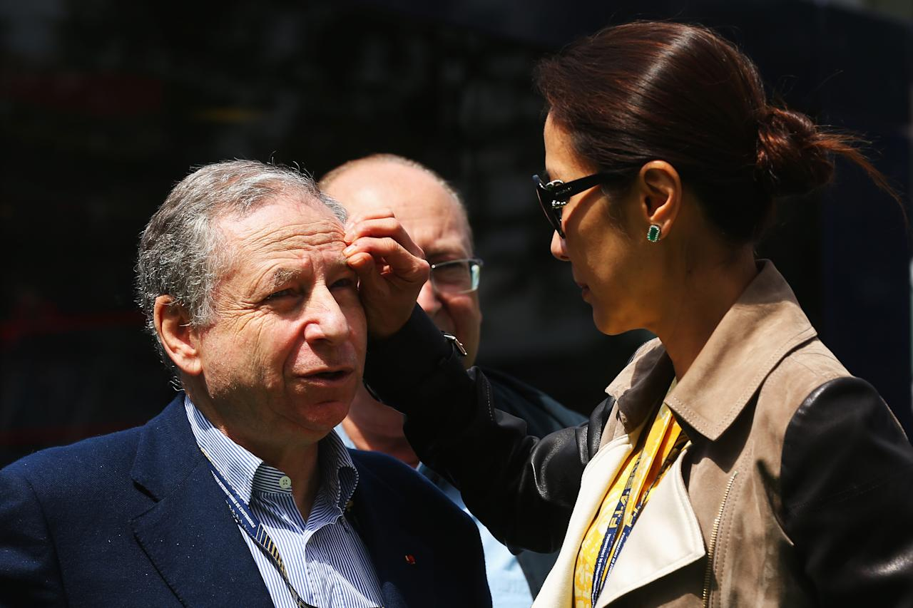 MONTMELO, SPAIN - MAY 12:  F.I.A. President Jean Todt is seen with his wife Michelle Yeoh in the paddock before the start of the Spanish Formula One Grand Prix at the Circuit de Catalunya on May 12, 2013 in Montmelo, Spain.  (Photo by Clive Rose/Getty Images)