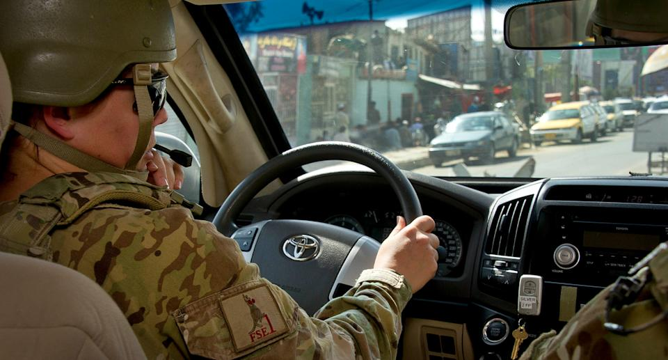 Australian troop drives car in Afghanistan.