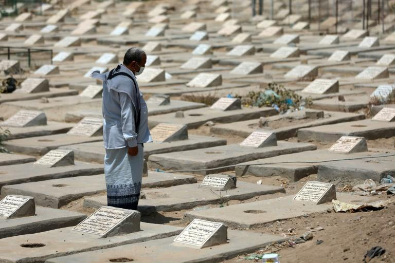 A man visits a cemetery allocated to Covid-19 victims in Yemen where officially more than a 1,000 deaths have been confirmed although experts believe the numbers are dramatically higher