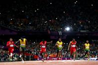 Usain Bolt of Jamaica crosses the finish line ahead of Ryan Bailey of the United States, Yohan Blake of Jamaica and Justin Gatlin of the United States to win the Men's 100m Final on Day 9 of the London 2012 Olympic Games at the Olympic Stadium on August 5, 2012 in London, England. (Photo by Michael Steele/Getty Images)