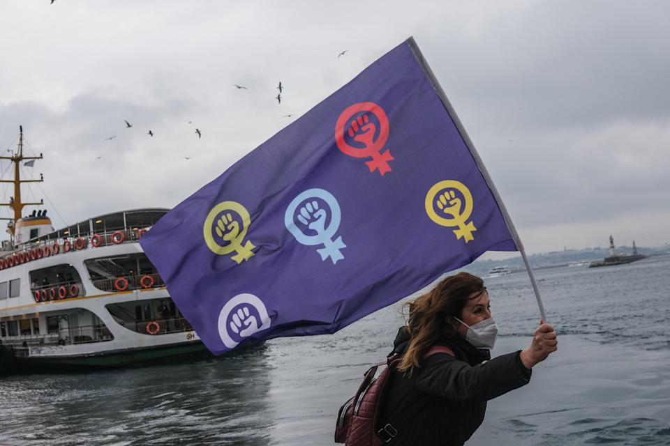 female protestor hold feminist flag and shout slogans during demonstration on the occasion of the International Day for the Elimination of Violence Against Women in Istanbul at the weekend (EPA)