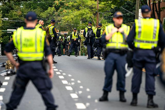 <p>Hundreds of state police officers descend upon downtown Charlottesville as the city marks the anniversary of last year's 'Unite the Right rally' in Charlottesville, Va., Aug. 11, 2018. (Photo: Jim Lo Scalzo/EPA-EFE/REX/Shutterstock) </p>