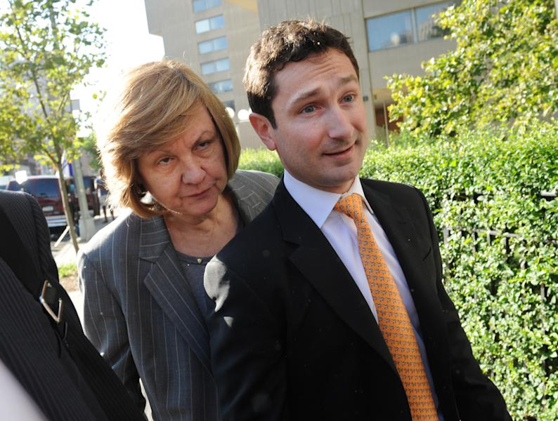 Former Goldman Sachs Group Inc. executive Fabrice Tourre, right, enters Manhattan federal court on the first day of his trial, Monday, July 15, 2013, in New York. Tourre is accused of misleading investors about the true prospects of their bet on a package of mortgage-based securities. (AP Photo/Louis Lanzano)