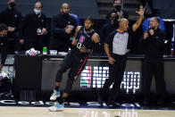 Los Angeles Clippers guard Paul George (13) reacts after making a 3-point basket during the second half of the team's NBA basketball game against the Phoenix Suns on Thursday, April 8, 2021, in Los Angeles. (AP Photo/Marcio Jose Sanchez)