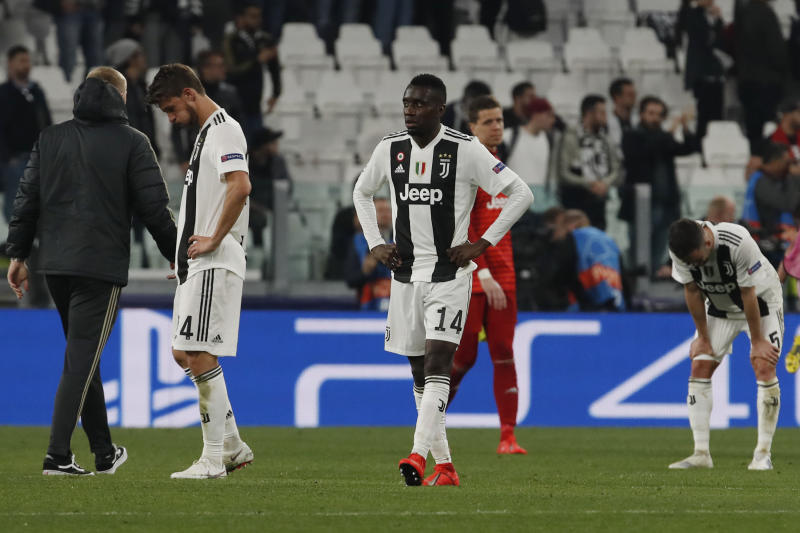 Juventus' players leave the pitch at the end of the Champions League quarter final, second leg soccer match between Juventus and Ajax, at the Allianz stadium in Turin, Italy, Tuesday, April 16, 2019. (AP Photo/Antonio Calanni)