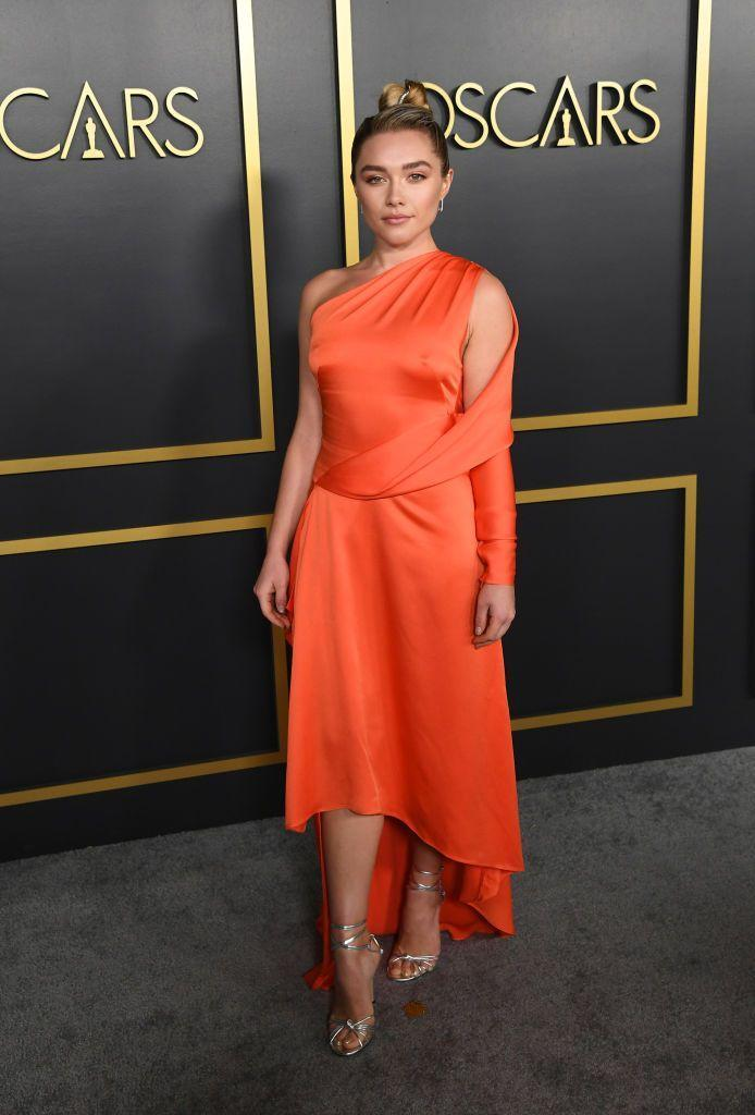 <p>The 24-year-old wore an asymmetric, sunset-orange dress to the 92nd Oscars Nominees Luncheon, January 2020.</p>