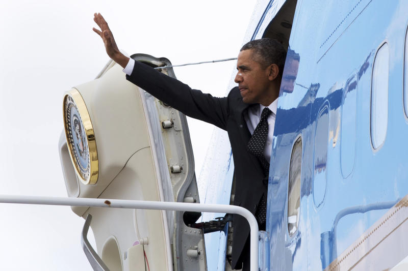 President Barack Obama waves as he boards Air Force One at Andrews Air Force Base, Md., Wednesday, Feb. 26, 2014, en route to St. Paul, Minn. In Minnesota he is expected to speak at Union Depot rail and bus station with a proposal asking Congress for $300 billion to update the nation's roads and railways, and about a competition to encourage investments to create jobs and restore infrastructure as part of the President's Year of Action. (AP Photo/Jacquelyn Martin)