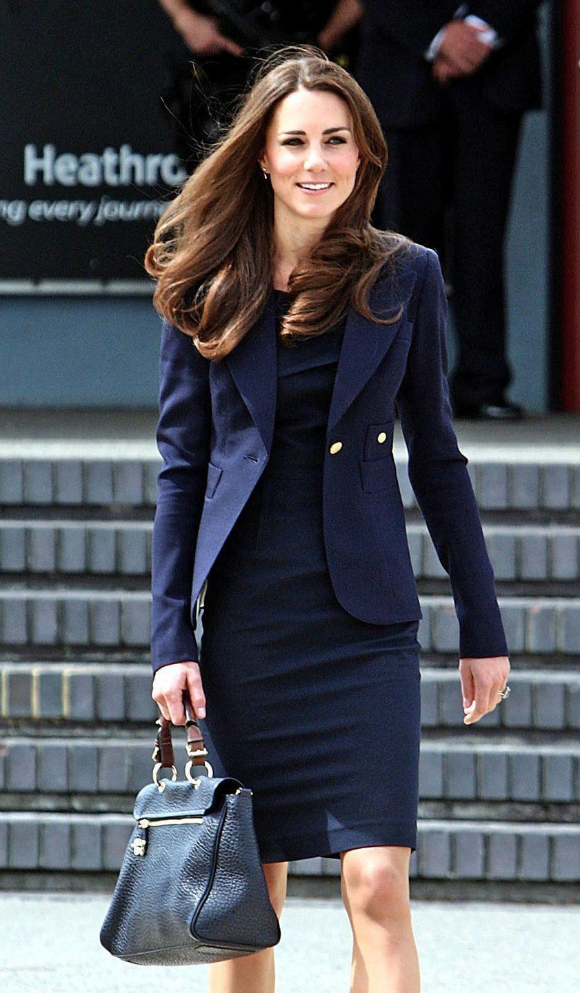 <p>Kate chose a navy blue dress for her first royal tour in Canada shortly after she got married, pairing the look with a blazer in the same hue.</p>