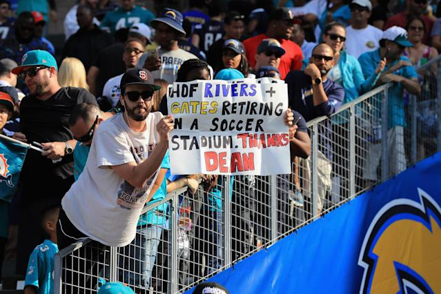 A fan demonstrates his bitterness that Phillip Rivers and Antonio Gates will finish their careers playing at StubHub Center. (Getty)