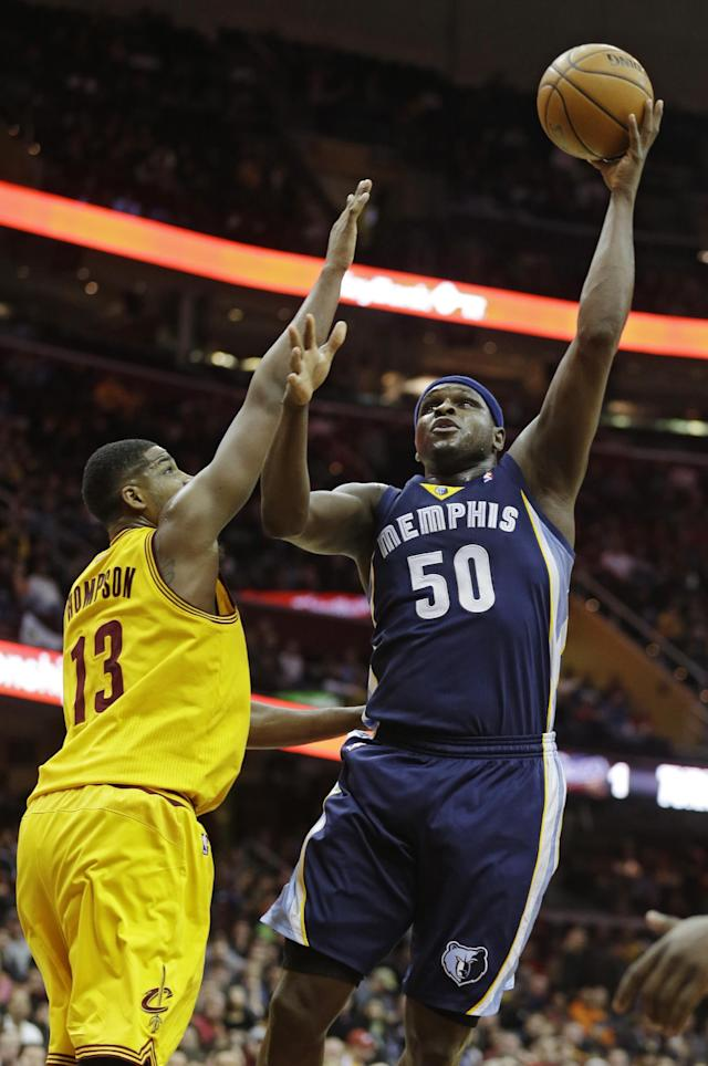 Memphis Grizzlies' Zach Randolph (50) shoots over Cleveland Cavaliers' Tristan Thompson (13) in the first quarter of an NBA basketball game on Sunday, Feb. 9, 2014, in Cleveland. (AP Photo/Mark Duncan)