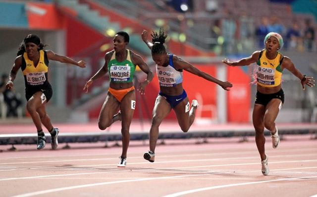Shelly-Ann Fraser-Pryce, right, beats Dina Asher-Smith to 100m gold