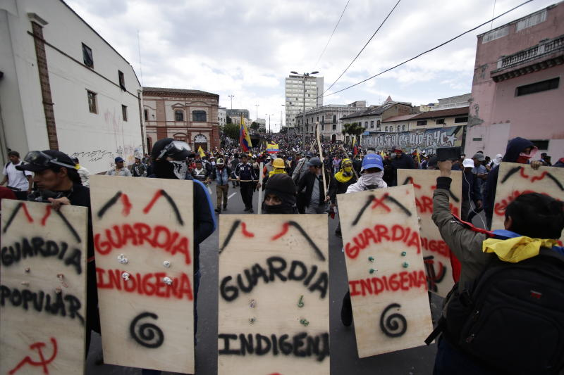 Indigenous anti-government demonstrators march against President Lenin Moreno and his economic policies during a nationwide strike, in Quito, Ecuador, Wednesday, Oct. 9, 2019. Ecuador's military has warned people who plan to participate in a national strike over fuel price hikes to avoid acts of violence. The military says it will enforce the law during the planned strike Wednesday, following days of unrest that led Moreno to move government operations from Quito to the port of Guayaquil. (AP Photo/Carlos Noriega)