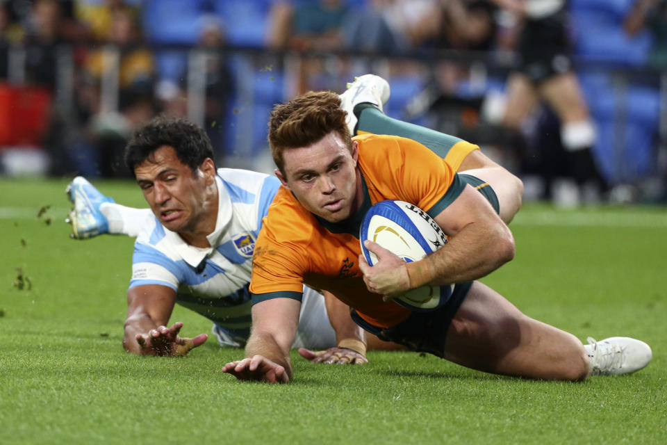 Australia's Andrew Kellaway, right, gets past Argentina's Matias Moroni, to score a try during their Rugby Championship test match on the Gold Coast, Australia, Saturday, Oct. 2, 2021. (AP Photo/Tertius Pickard)