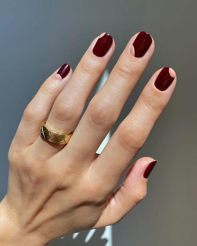 """<p>For the nail art newbies, this abstract design is approachable enough to attempt at home. It's never a bad idea to add one more cranberry-red nail polish to your collection, either. </p><p><a href=""""https://www.instagram.com/p/CE12QWFjtuH/"""" rel=""""nofollow noopener"""" target=""""_blank"""" data-ylk=""""slk:See the original post on Instagram"""" class=""""link rapid-noclick-resp"""">See the original post on Instagram</a></p>"""