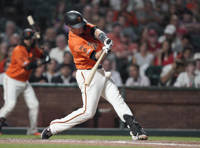San Francisco Giants' Buster Posey hits a single to drive in a run against the Miami Marlins during the sixth inning of a baseball game Friday, Sept. 13, 2019, in San Francisco. (AP Photo/Tony Avelar)