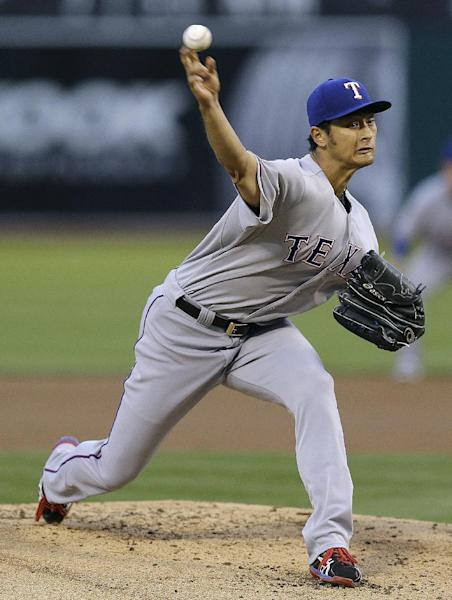 Texas Rangers' Yu Darvish works against the Oakland Athletics in the first inning of a baseball game Monday, April 21, 2014, in Oakland, Calif. (AP Photo/Ben Margot)