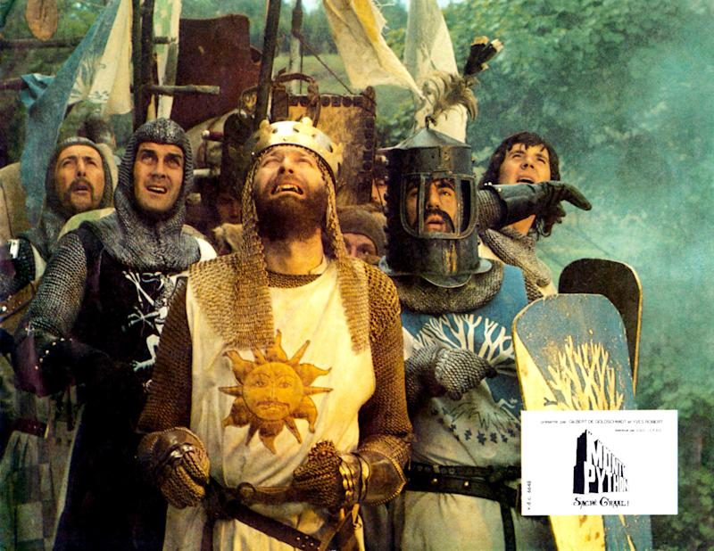 Monty Python And The Holy Grail, lobbycard, rear from left: Eric Idle, Michael Palin, center from left: John Cleese, Terry Jones (helmet), Graham Chapman as King Arthur (front), 1975. (Photo by LMPC via Getty Images)