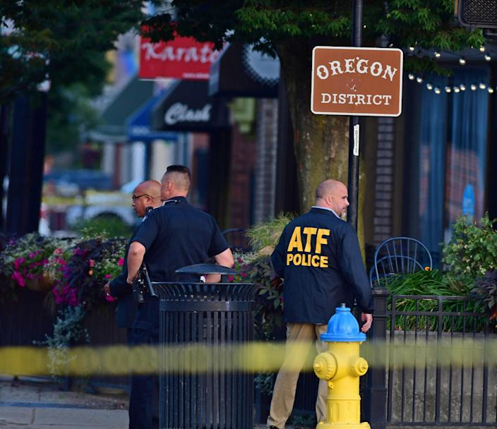 Police officers at the crime scene in Dayton, Ohio on August 4, 2019 following the mass shooting in the Oregon district of Dayton. (Photo: Tom Russo/EPA-EFE/Shutterstock)