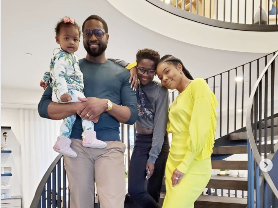 """Zaya Wade, 12 (center), pictured with her NBA-star father Dwyane Wade, his wife Gabrielle Union and the couple's baby girl Kaavia, has recently begun using pronouns """"she"""" and """"her."""" (Screenshot: Instagram/GabUnion)"""