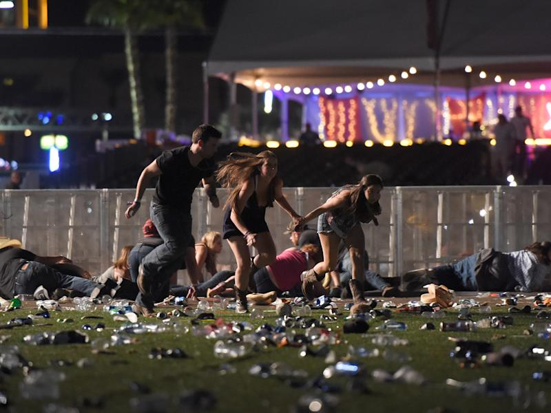 People run from the Route 91 Harvest country music festival in Las Vegas after a shooter opened fire: Getty Images
