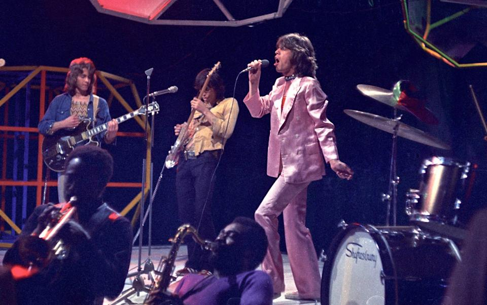 Mick Taylor, Keith Richards, Mick Jagger - performing on Top Of The Pops TV Show - Ron Howard/Redferns