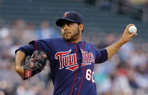 Minnesota Twins starting pitcher Pedro Hernandez throws against the Chicago White Sox during the first inning of a baseball game, Monday, May 13, 2013, in Minneapolis. (AP Photo/Genevieve Ross)