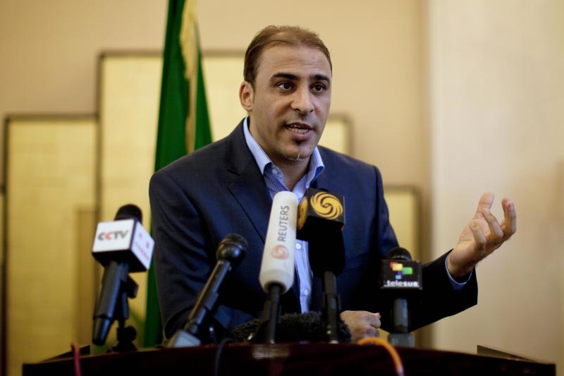 FILE - In this Saturday, Aug. 13, 2011 file photo, Libya's government spokesman Moussa Ibrahim speaks to the press at a hotel in Tripoli, Libya. Ibrahim was captured as he was trying to flee Bani Walid, according to the Libyan State News Agency, Saturday, Oct. 20, 2012. The town has been the site of fierce fighting between pro-government forces and fighters holed up in the longtime Gadhafi stronghold. (AP Photo/Dario Lopez-Mills, File)