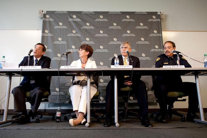 From left, Barry Shur, Ph.D., the Dean of the Graduate School at the University of Colorado, Lilly Marks, Vice President for Health Affairs University of Colorado, Don Elliman, University of Colorado-Denver Chancellor, and Doug Abraham, Chief of Police for the University of Colorado, hold a news conference Monday, July 23, 2012, in Aurora, Colo. The conference was called to discuss the program, procedure and policy that surround the Neuroscience program that James Holmes was recently enrolled in before allegedly killing 12 and injuring dozens of others in a shooting at an Aurora, Colo. movie theater last Friday. University officials won't say whether they saw any signs of academic or behavioral trouble in Holmes. (AP Photo/Barry Gutierrez)