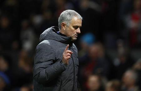 Manchester United manager Jose Mourinho walks off after the game