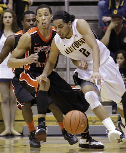 California's Jorge Gutierrez, right, drives the ball against Oregon State's Jared Cunningham (1) during the first half of an NCAA college basketball game on Saturday, Feb. 18, 2012, in Berkeley, Calif. (AP Photo/Ben Margot)
