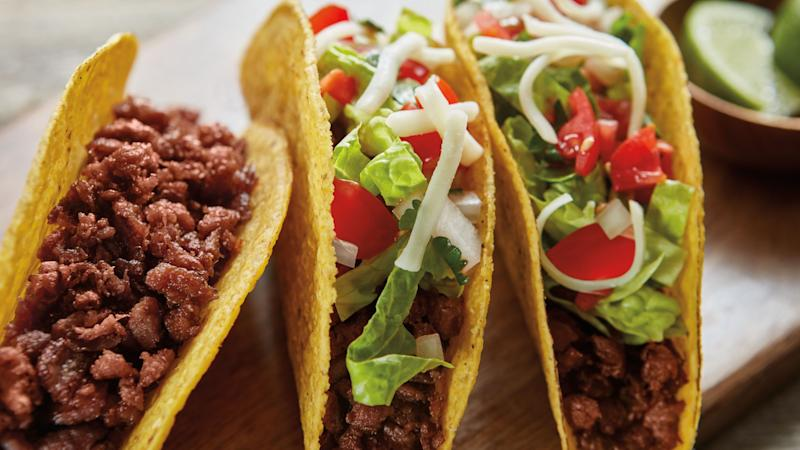 Three ground beef tacos made with Beyond Beef.