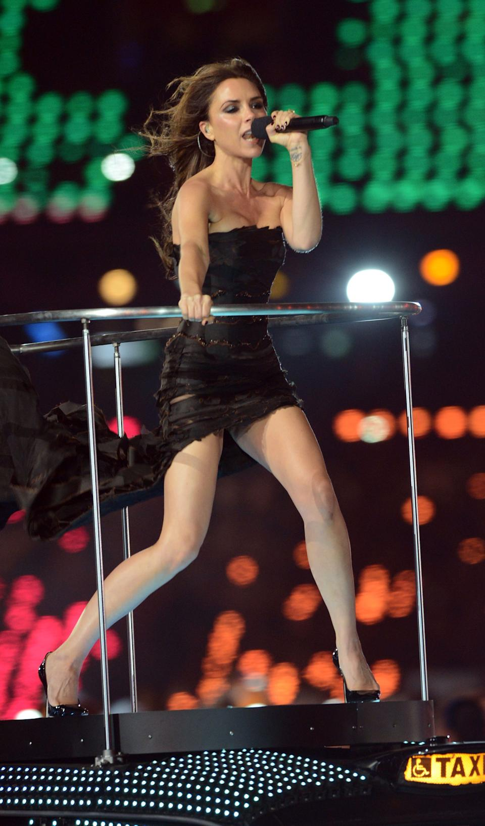 Victoria Beckham of The Spice Girls performs during the closing ceremony of the London 2012 Olympic games, London   (Photo by Anthony Devlin/PA Images via Getty Images)