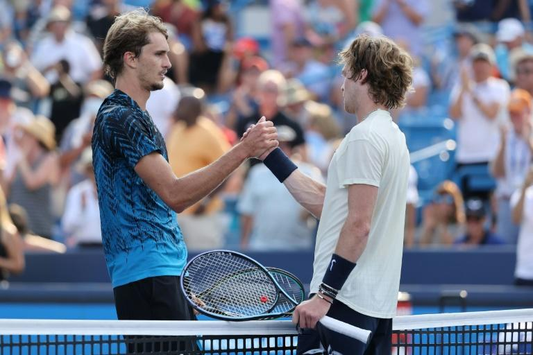 Old friends: Germany's Alexander Zverev shakes hands with Andrey Rublev after beating the Russian in the final of the ATP Cincinnati Masters