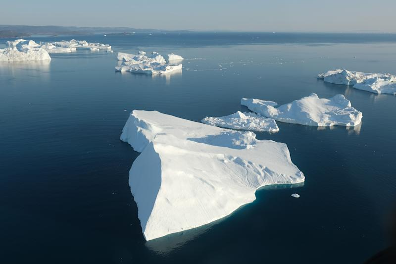In this view from an airplane icebergs float at the mouth of the Ilulissat Icefjord near Ilulissat, Greenland. (Photo: Sean Gallup/Getty Images)