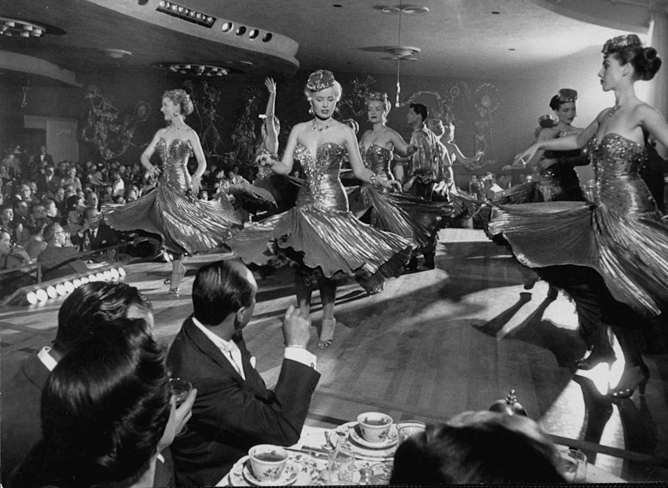 <p>Showgirls dance on stage in 1952. The iconic Vegas showgirl first started in the 1950s and the idea came from Paris. </p>
