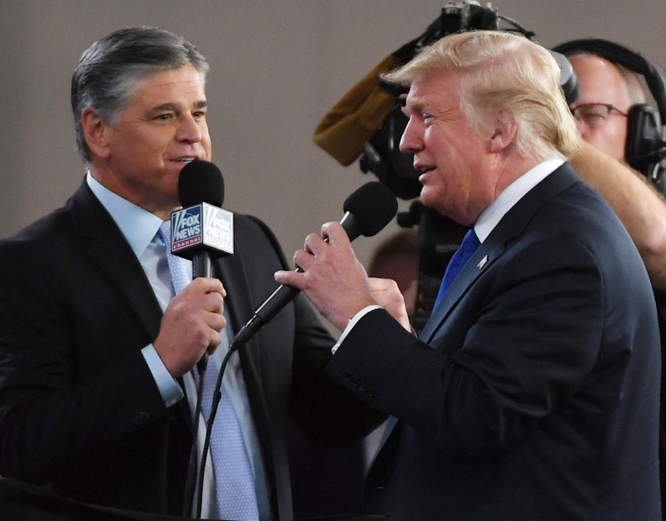 Fox News Channel and radio talk show host Sean Hannity interviews Trump before a campaign rally in 2018. Hannity has sycophantically defended Trump throughout the pandemic. (Photo: Ethan Miller via Getty Images)