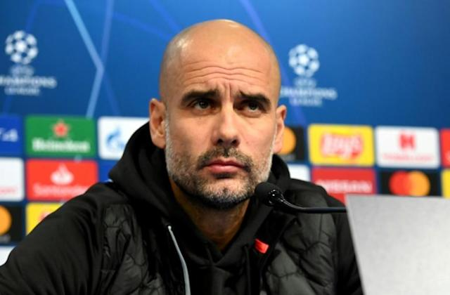 Pep Guardiola says he has to earn a new Manchester City contract (AFP Photo/Denis LOVROVIC)