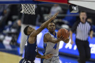 Creighton guard Shereef Mitchell (4) makes a lay up against Xavier guard KyKy Tandy (24) in the first half during an NCAA college basketball game on Wednesday, Dec. 23, 2020, in Omaha, Neb. (AP Photo/John Peterson)