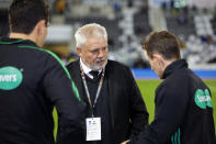 Chiefs head coach Warren Gatland, centre, with officials ahead of the the Super Rugby Aotearoa rugby game between the Highlanders and Chiefs in Dunedin, New Zealand, Saturday, June 13, 2020. Super Rugby Aotearoa is the first major rugby union tournament to resume since the COVID-19 outbreak and one of the first major sports events in the world at which there will be no limitation on crowd size. (Derek Morrison /Photosport via AP)