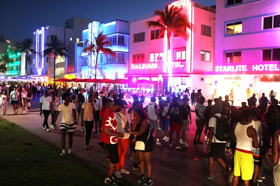 MIAMI BEACH, FLORIDA - MARCH 18: People enjoy themselves as they walk along Ocean Drive on March 18, 2021 in Miami Beach, Florida. College students have arrived in the South Florida area for the annual spring break ritual. City officials are concerned with large spring break crowds as the coronavirus pandemic continues. They are advising people to wear masks if they cannot social distance.  (Photo by Joe Raedle/Getty Images)